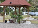 Gazebo with stunning views all around with a large number of fruit trees on the property