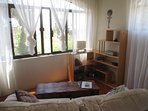 Bed Sitting Area; loveseat, coffee table & bookshelves