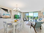 Bright and beachy living & dining room with a direct view of the ocean