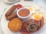"""ALL DAY FULL ENGLISH BREAKFAST"" available at Benny's Diner just two miles up the road."