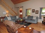 Large open Living room with a sleeper sofa, couch & 2 Recliner Chairs