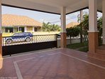 Carport with gate and space for 2 cars.