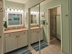 Primary bathroom and shower with grab bar for safety.