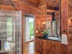RUSTIC shower with pebble bottom floor.