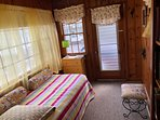 Twin bed / perfect for adult or child ( Butterfly themed!) bright with new ceiling fan