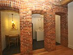 The historic brick walls which hold a small breakfast table and washer dryer for your convenience.