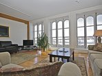 The entire condo boasts 8 foot tall windows with a view on the Saint-Lawrence River and Old Quebec.