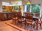 Dining & kitchen with tropical gulch view