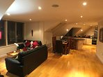 Exeter penthouse - Night time shot of open-plan living space