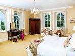 Six huge  windows in huge bedroom luxury bathroom