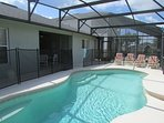 Outside pool area with 2 loungers and 2 recliner chairs  with stools