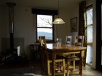 Dining area with fab views over the hills and opening onto the south facing sunny walled garden.