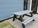 New heavy resin picnic bench outside the property  - ideal for alfresco dining