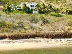 Ocean Song Villa located above Turtle Beach with unobstructed views of the reef, ocean and Nevis.