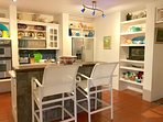 Fully equipped kitchen with ocean views opening to the decks & pool, perfect for preparing a meal.