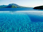 View from Ocean Song Villa's infinity edge pool with Nevis in background.