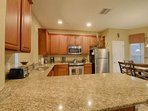 Modern Kitchen - Tile Flooring, Stainless Steel Appliances & Granite Counter Tops
