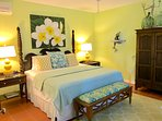 Main level 3rd bedroom with king size bed, ensuite bathroom. Ocean views, AC & ceiling fan.