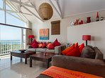Bright and airy living area with sea views.