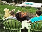 Roasting marshmallows around the fire. 2 kayaks are included for your use!