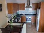 Modern kitchen with fridge freezer, washing machine and dishwasher