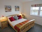 King Size en-suite bedroom downstairs