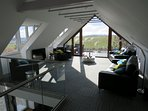 Main living room upstairs with a view