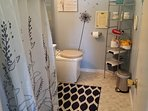 Full Bath with electric incinerating toilet, shower, and vanity