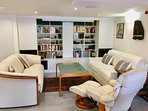 Living room includes home cinema, hifi system and large choice of CD's and DVD's