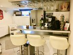 Fully-equipped modern kitchen with bar, seating for 4 guests, pots and pans included