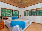 Luxurious King bed with private Tropical Rainforest Views