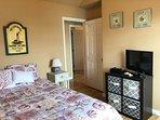 Second bedroom, queen bed, TV, very comfortable.