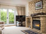 The characterful sitting room, with a cosy real fire