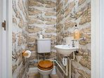 The ground floor cloakroom contains a toilet and wash basin