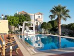 Pool area with a variety of furnished spots for your relaxation.