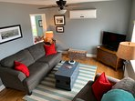 cozy living room area with smart Tv ,satelite programming and heat/cooling pump.