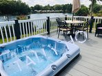 Large hot tub in sunken deck over looking lake