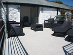 Enjoy the sun on the recliners on the upper terrace
