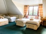 Large family first floor bedroom, with 1 double king size bed and 3 singles