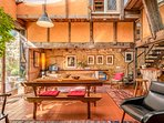 Looking South; this image shows the warmth and eclecticism of the dining space