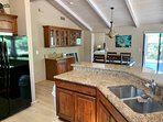 Kitchen has lots of work surfaces and the Dining area has a wet bar!