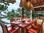 diningarea with pool and seaview