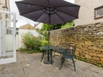 Courtyard garden at the rear of the property with BBQ available for use