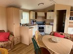 Fully-equipped kitchen with fridge, microwave, gas hob and oven