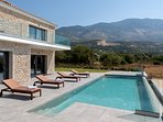 Infinity swimming pool and Ainos mountain view