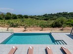 Infinity swimming pool and Trapezaki bay view
