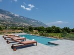 sun beds and, infinity swimming pool and terrace