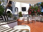 main terrace with alfresco dinning - breakfast lunch and dinner - sail is added in the summer months
