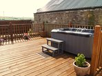 Soak away all your stresses in your own private hot tub.