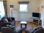Cosy Sitting Room, the TV has over 600 channels as well as OnDemand Movies and Boxsets